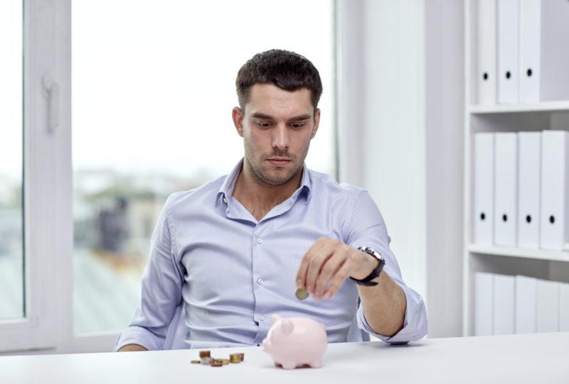 latino hispanic man with money piggy bank savings